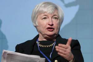 Federal Reserve Chairman Janet Yellen plans to increase interest rates.  Can government and households survive the shock? [Credit: Huffington Post]